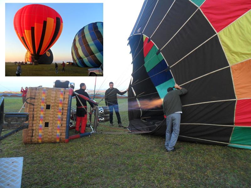 Balões no solo, ficando cheios de ar quente para subir.